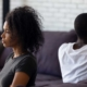 Sad unhappy african wife avoiding talk ignoring husband after couple fight feels indifferent offended